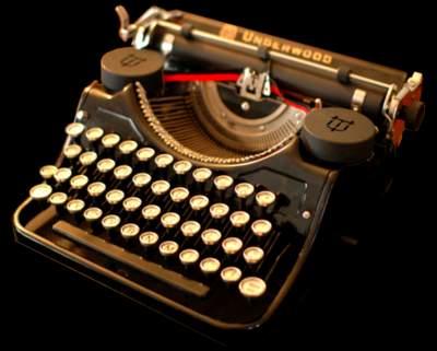 machine-a-ecrire-fond-noir-reduit.jpg